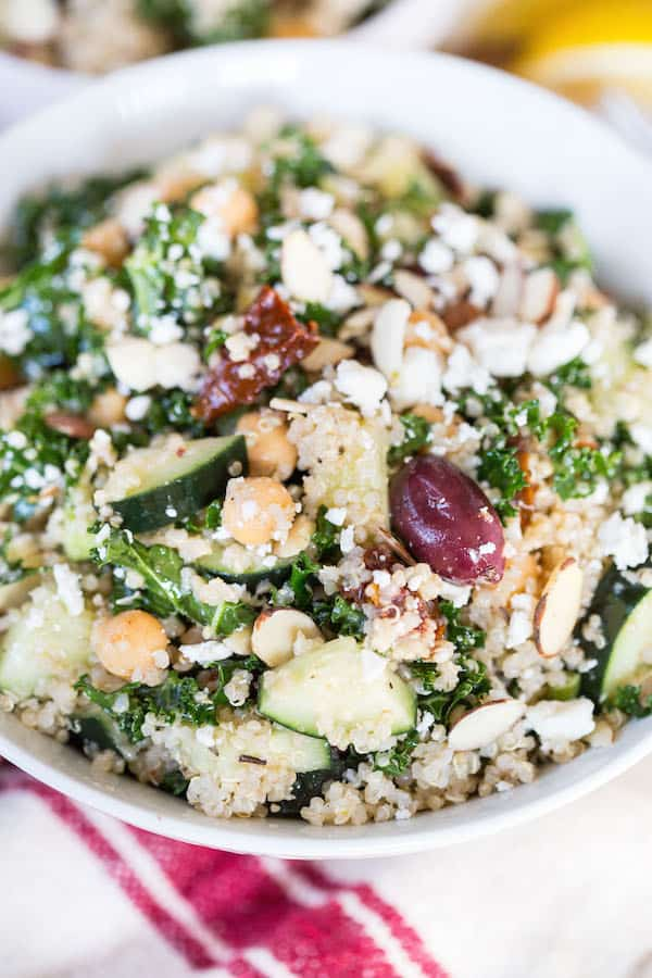 Mediterranean Quinoa and Kale Salad - Closeup on the Bowl with a Towel Underneath