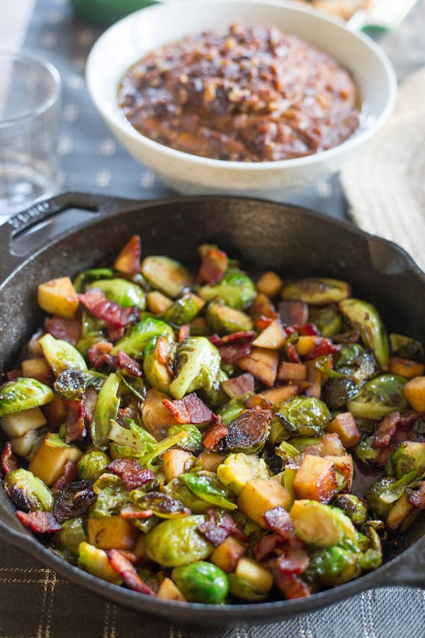 Maple Bacon Brussels Sprout Skillet with Other Dishes on the Table