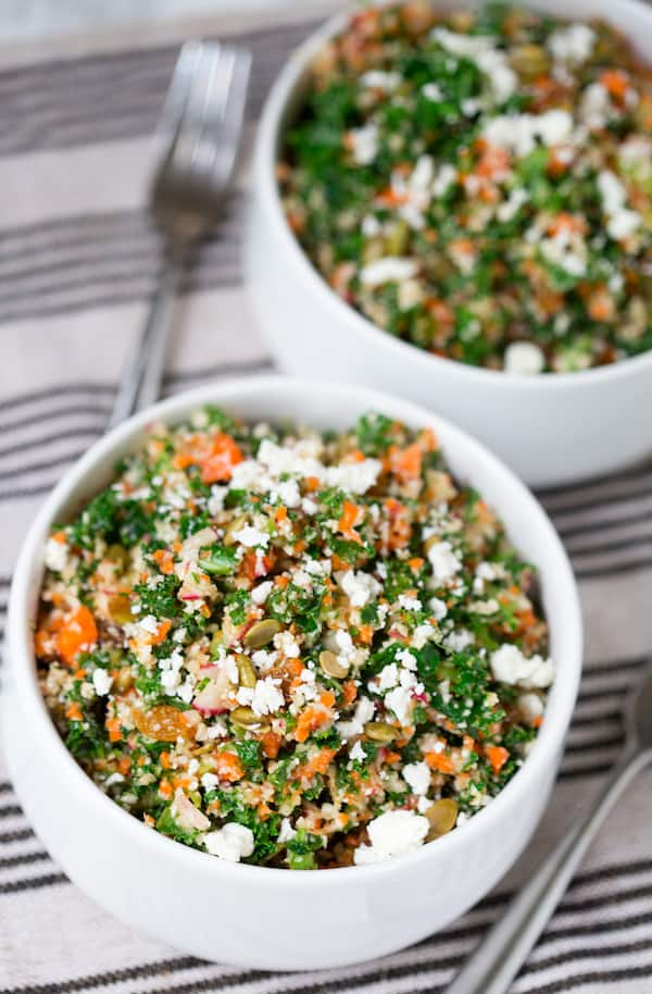Detox Chopped Kale Salad in Two Bowls on the Table Covered with a Cloth with Black and White Stripes