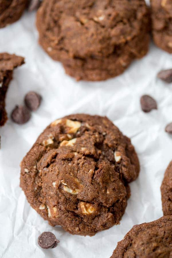 Triple Chocolate Cookies overhead shot with chocolate chips around the cookie