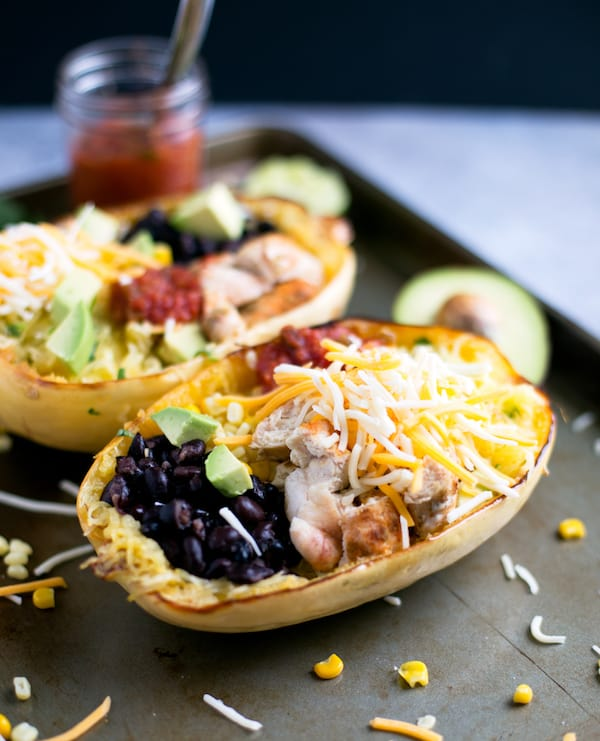 Spaghetti Squash Chicken Burrito Bowls Served in a Tray with Avocado on the Side