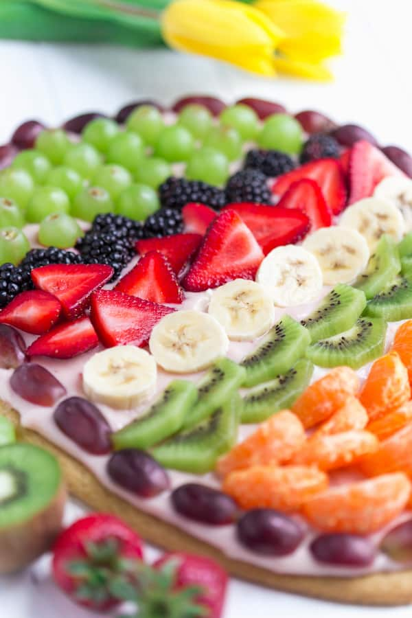 Easter Egg Fruit Pizza Closeup on the Beautiful Dish Full of Colorful Fruits