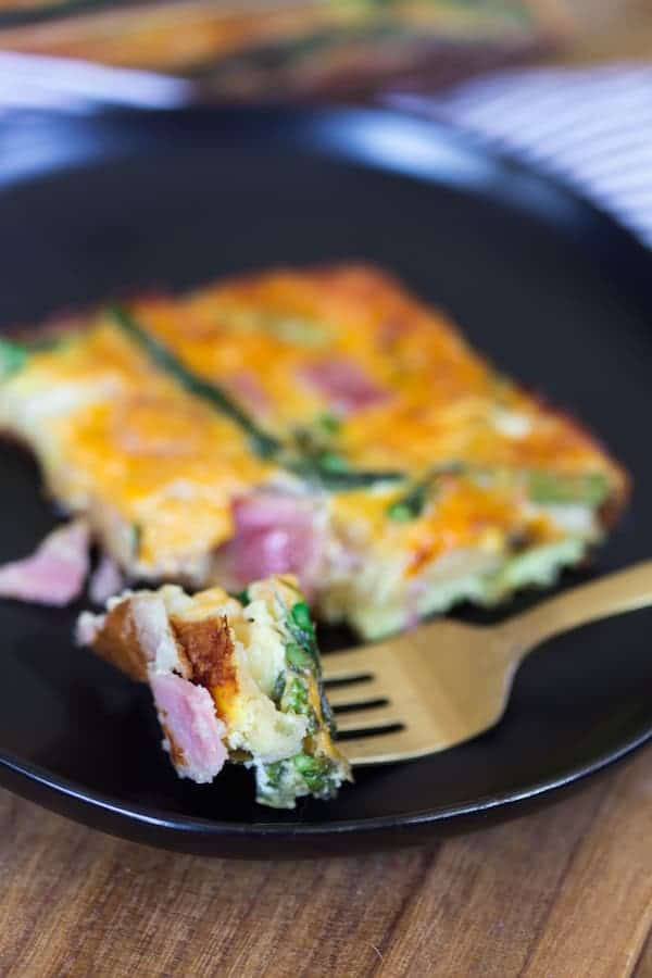 Ham Asparagus and Cheese Crescent Roll Breakfast Casserole with a Fork in a Plate Ready for the First Try