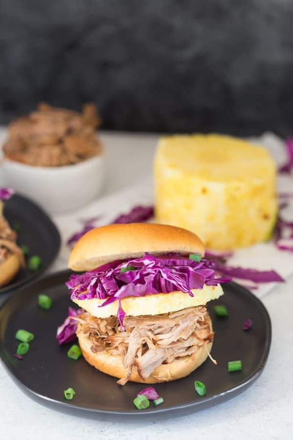 Pressure Cooker Hawaiian Pulled Pork Sandwiches Served on the Dark Plate with the Dark Grey Background
