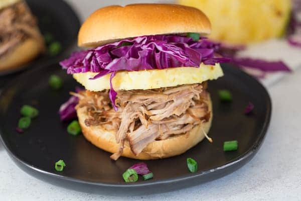 Pressure Cooker Hawaiian Pulled Pork Sandwiches Closeup on One of Them Served in a Small Black Plate