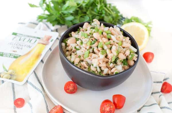 White Bean Tuna Salad Served in a Bowl with E.V.O.O. Yellowfin Tuna Pack and Lots of Cherry Tomatoes Around
