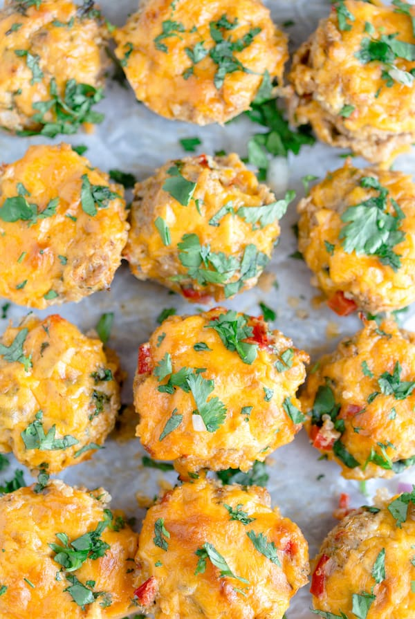 Cheesy Chicken Taco Meatloaf Muffins - Overhead on the Pan Full of Cute Little Muffins